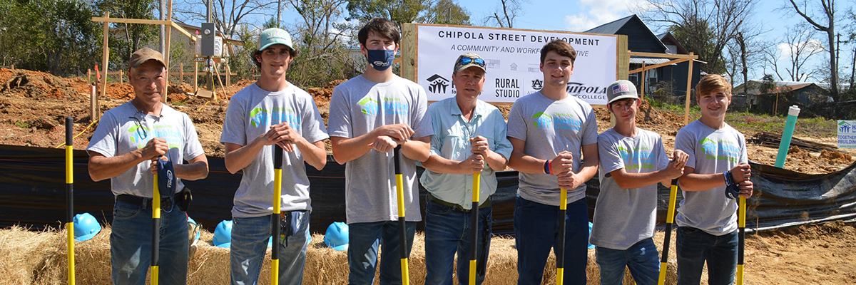 Chipola College Building Construction students pose with golden shovels during a ground-breaking ceremony.